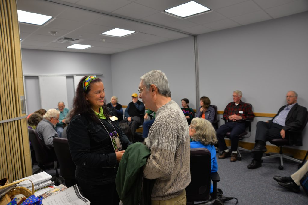Judy Pamp of the Ziibiwing Center of Anishinaabe Culture & Lifeways speaks to a program participant during the Anishinaabe 101 Workshop in November 2016.
