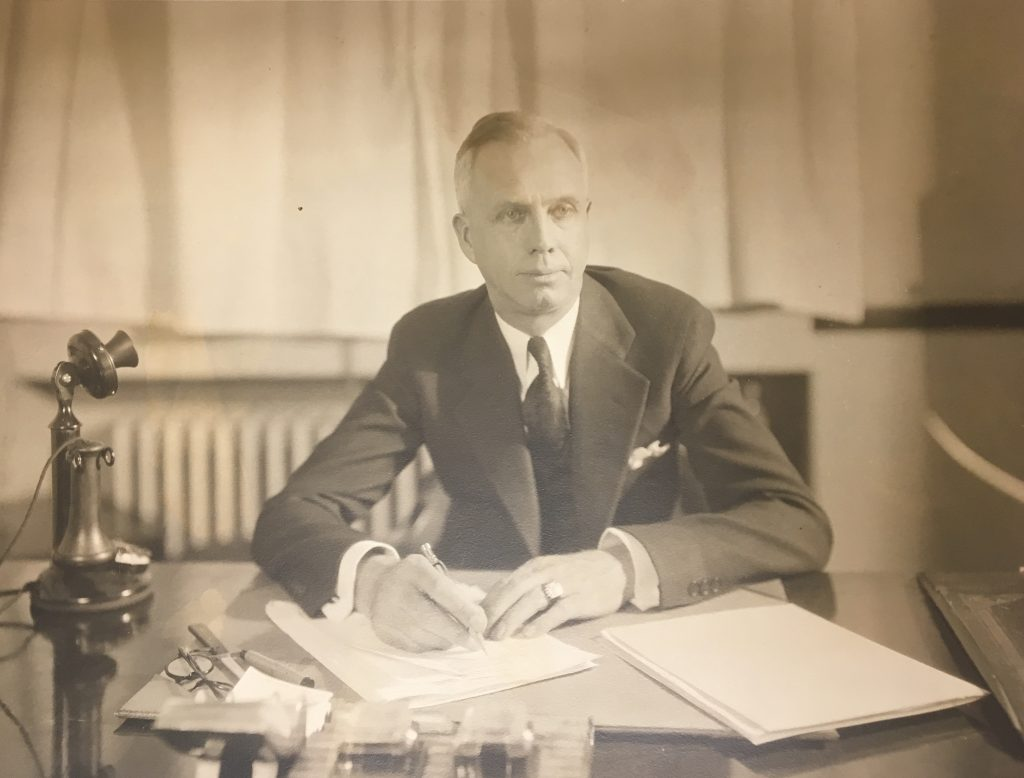 Albert M. Ewert at his desk at the Michigan State Prison, c. 1933 [Archives of Michigan]