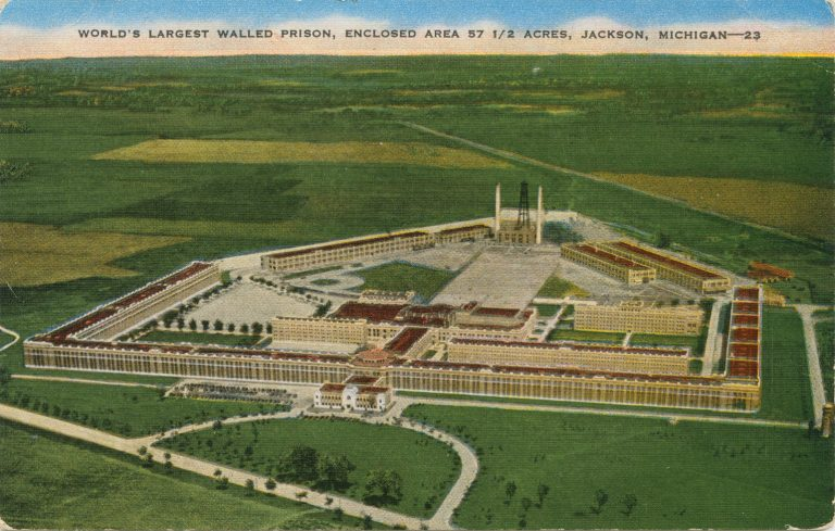 Bird's eye view illustration showing Jackson Prison and it's 5-sided wall, amidst vast fields of green.