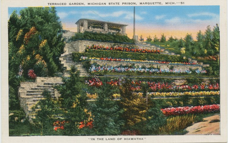 Illustrated postcard showing lush terraced gardens with colorful flowers leading up to a stone building at the top of a hill.
