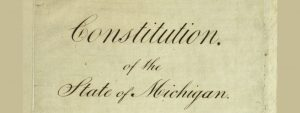 "Color image of the first page of Michigan's 1835 constitution reading ""Constitution of the State of Michigan."""