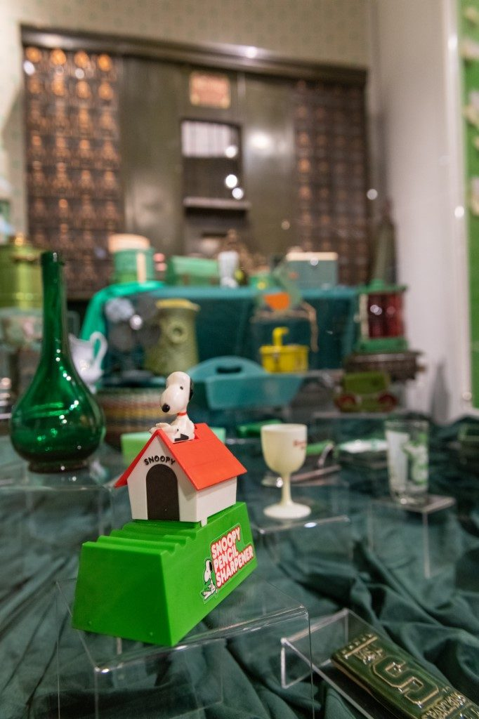 A display of green artifacts, featured in Secret Lives of Michigan Objects.