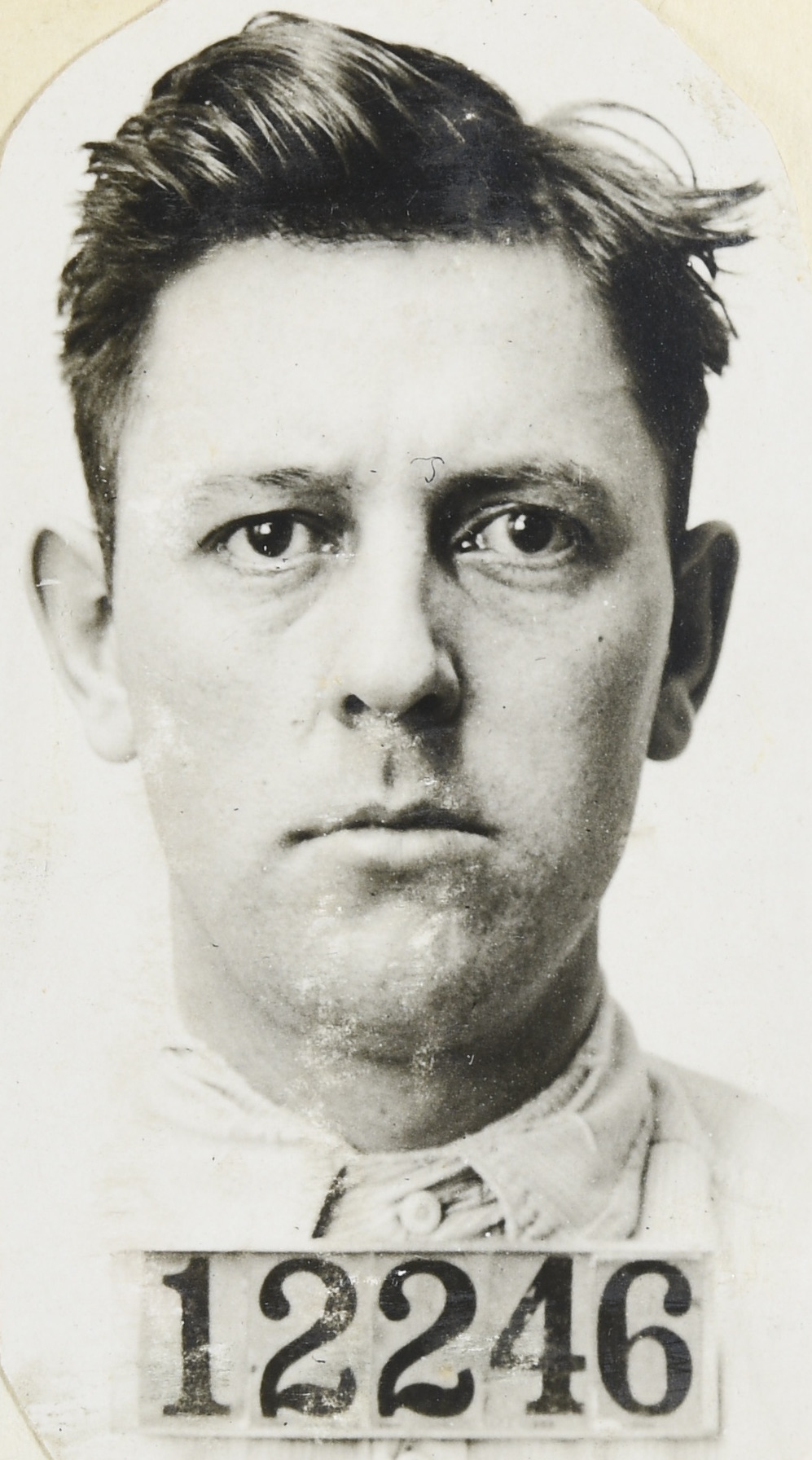 Prisoner mugshot of Fred Burke from the State Prison of Southern Michigan in Jackson, front view only. His prisoner number shown is 12246.