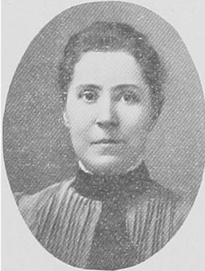 Black and white portrait of a women with her hair pulled back and wearing a dark collar.