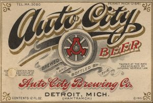 Vintage label for Auto City Beer - decorative font with red accents.